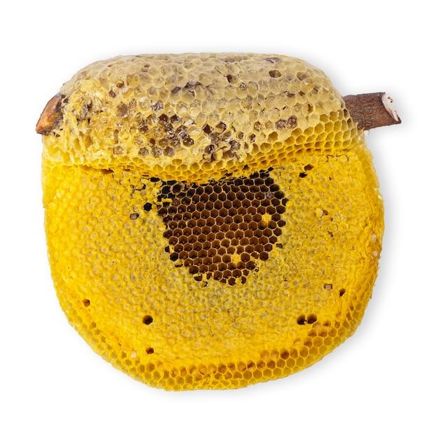 Honingraat geïsoleerd op een witte achtergrond. honingraat uitknippad