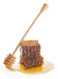 Honingraat met houten stok