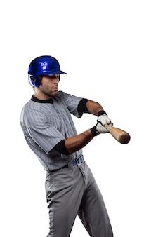 Honkbalspeler in een blauw uniform, op een witte achtergrond.