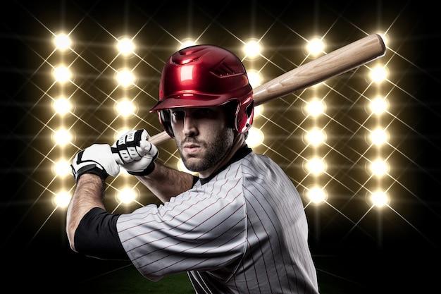 Honkbalspeler voor lichten.