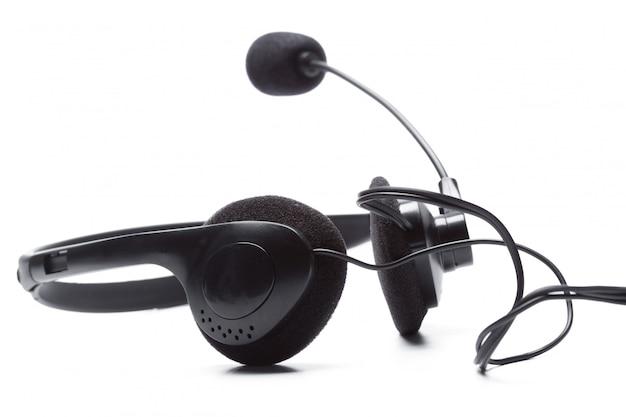 Hoofdtelefoon met microfoon op wit wordt geïsoleerd dat