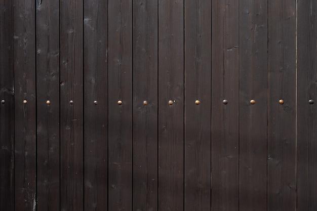 Horizontaal naadloze textuur van oude planken met metalen klinknagels. achtergrond met kopieerruimte