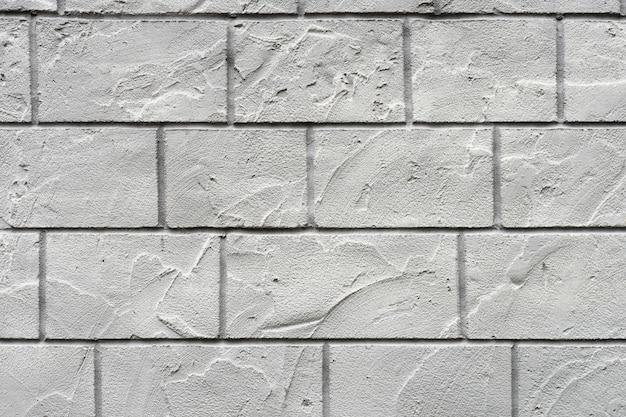 Horizontale betonnen muur gestructureerde achtergrond. wit grijze rustieke kleur. grungy shabby uneven painted pleister.
