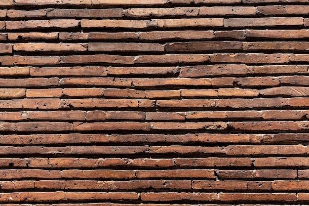 Horizontale bruine bakstenen muur achtergrond