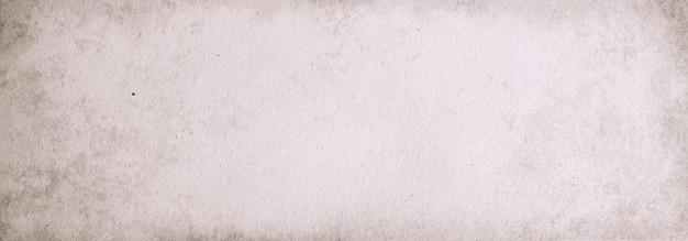 Horizontale papier met een beige achtergrond van een vintage grijze kartonnen banner textuur plaats voor tekst