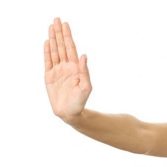 Hou op! vrouwenhand gesturing geïsoleerd op wit