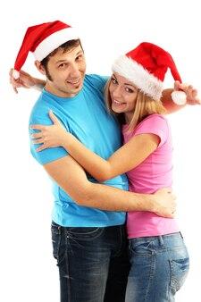 Houdend van paar in santa hoeden op wit