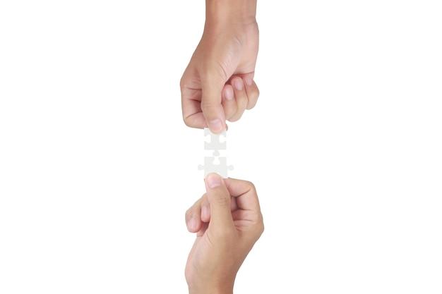 Houdt in de hand puzzel. succes en strategieconcept voor bedrijfsoplossingen