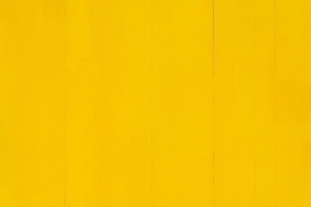 Houten achtergrond geschilderd in heldere gele kleur.