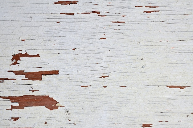 Houten achtergrond geschilderd met witte verf in grunge stijl.