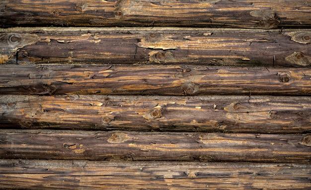Houten achtergrond. oude houten muur van een rustiek huis met textuur