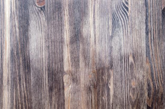 Houten achtergrond van textuurraad van donkere kleur