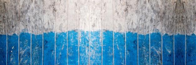 Houten bord blauwe en witte kleur geschilderd houten muur als achtergrond of textuur, natuurlijk patroon. lege kopie ruimte.