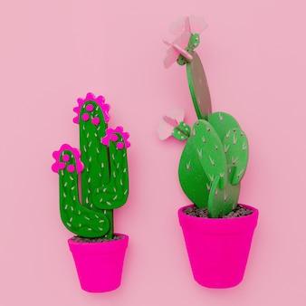 Houten cactus op roze achtergrond. planten op roze concept