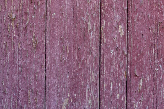 Houten gebarsten rode achtergrond voor decoraties en screensavers. detailopname