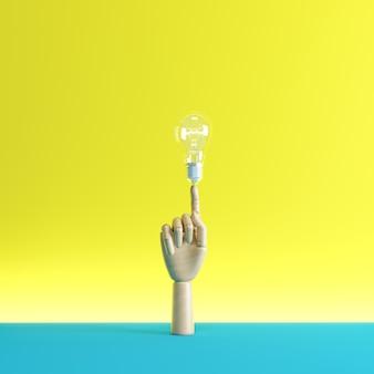 Houten handvinger wijst naar een verlichtingslamp.