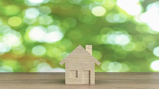Houten huis op houten tafel voor het bouwen van inhoud
