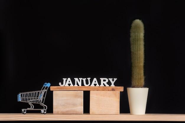 Houten kalender van januari cactus en miniatuur trolley kaart