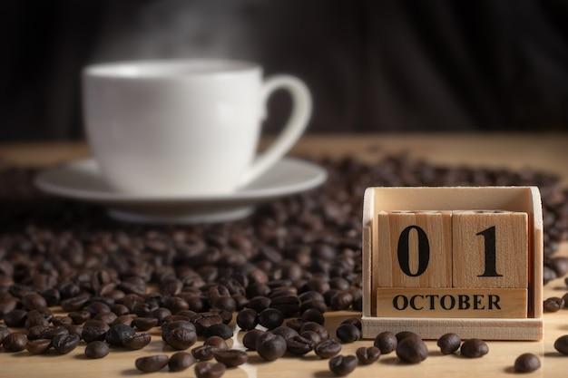 Houten kalenderblokken met de datum voor de internationale dag van de koffie