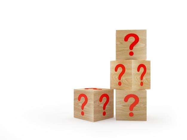Houten kubussen met vraagtekens op een stapel.