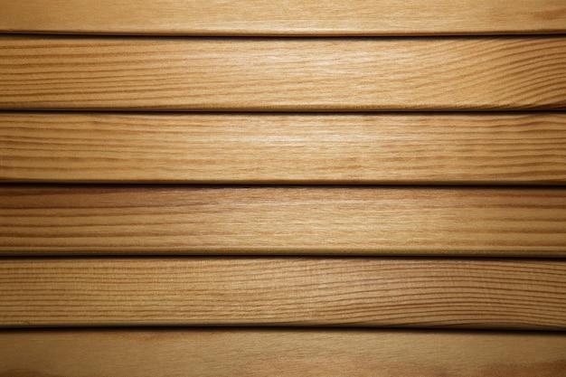 Houten lamellen textuur. houten jaloezieën close-up