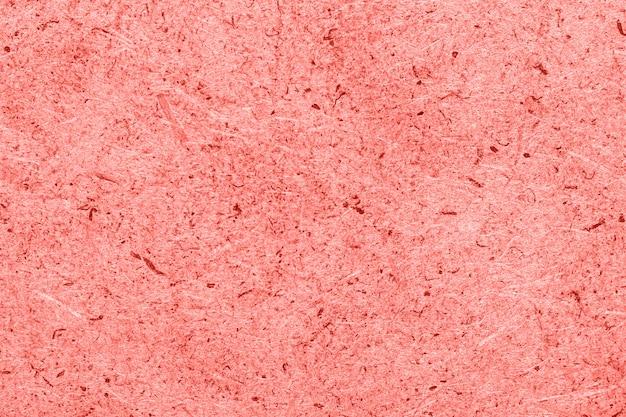 Houten muur samengeperst zaagsel of spaanplaat in gestemd koraal, als achtergrond, textuur