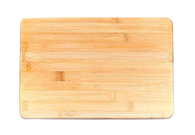 Houten plaat, lade, tafel voor het koken of warme gerechten op wit wordt geïsoleerd