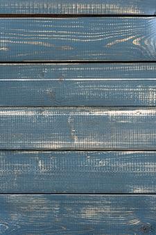Houten plank met gebarsten verf