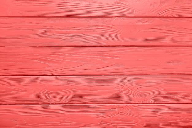 Houten planktextuur of achtergrond van geschilderde lijst in levende koraalkleur.