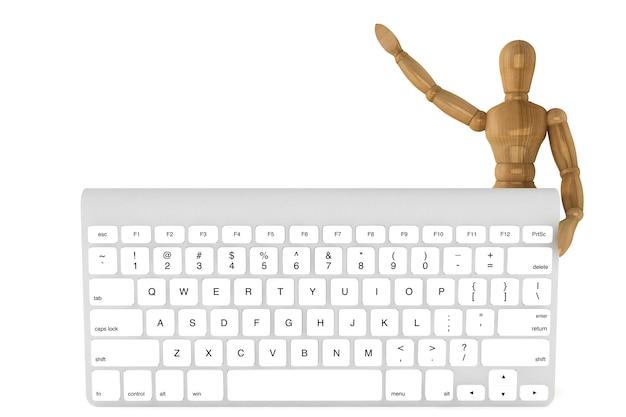 Houten pop met computertoetsenbord op een witte achtergrond