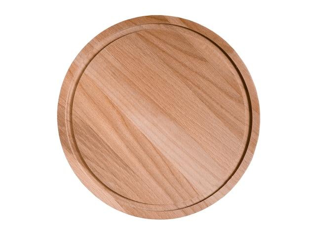 Houten ronde snijplank op houten tafel kopieerruimte
