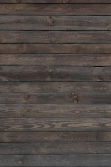 Houten ruimte. oude donkere houten oppervlak. houten planken. grove textuur. verticaal frame