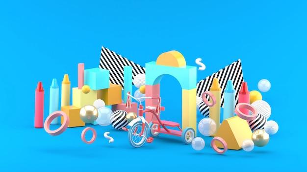 Houten speelgoed, krijt en fietsen tussen kleurrijke ballen op een blauwe ruimte. -3d render.