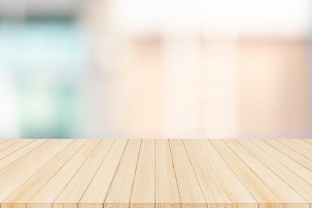 Houten tafelblad op onscherpe abstracte achtergrond - kan worden gebruikt voor weergave of montage van uw producten