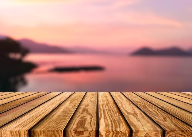 Houten tafelblad op wazige scène kleurrijke lucht op het meer op het platteland bij avondachtergrond