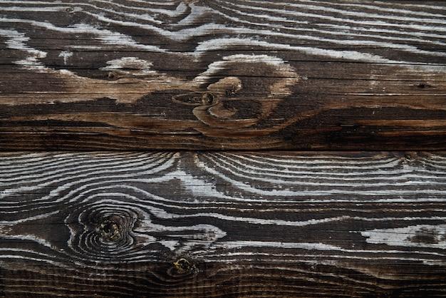 Houten textuur van donkerbruine planken.