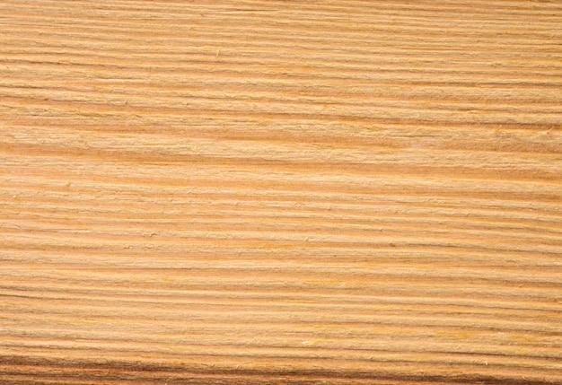 Houten textuur van gesneden boomstam, close-up achtergrond