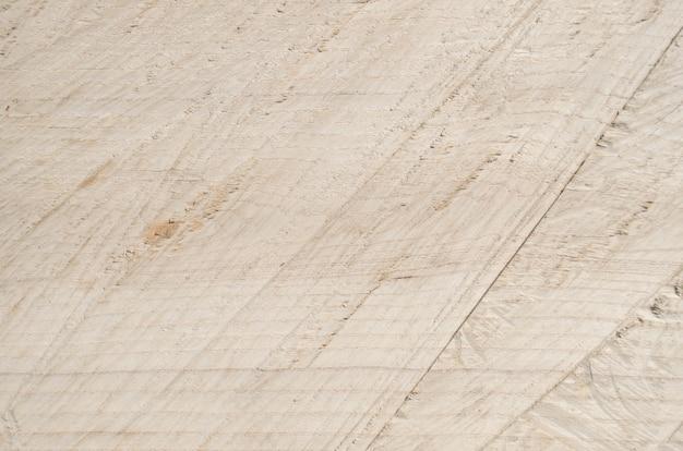 Houten textuur van gezaagd hout, bovenaanzicht. snijd een lichtbord langs een boomstam
