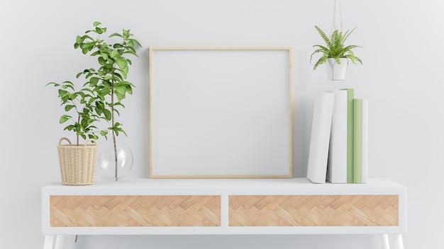 Houten vierkant frame mockup op een console met groene planten en boeken 3d-rendering