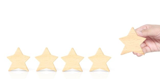 Houten vijfsterren in handvorm. de beste uitstekende zakelijke dienstverlening