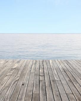 Houten vloer en blauwe zee met golven en heldere blauwe hemel
