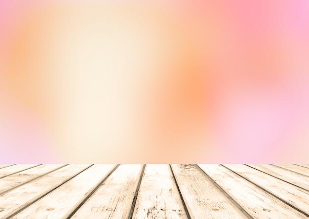 Houten vloer en roze abstracte wazige achtergrond