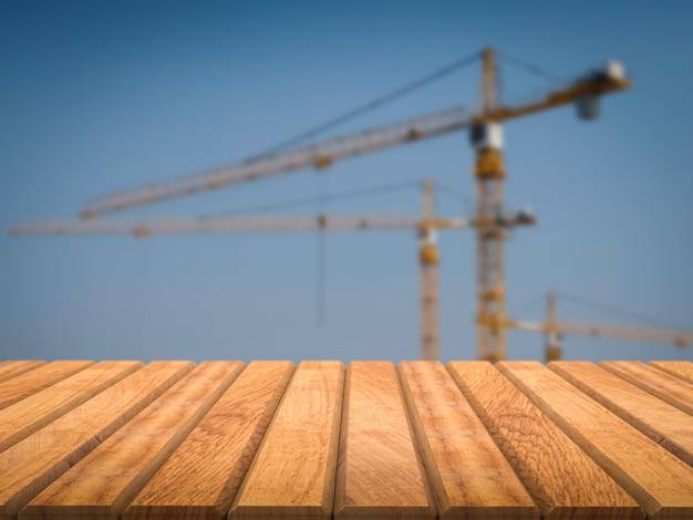 Houten vloer met bouwkraanachtergrond