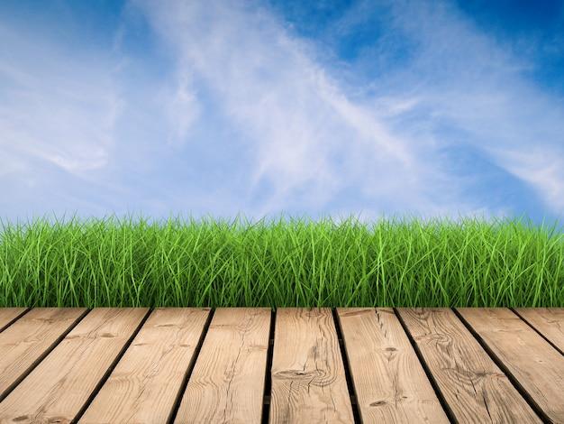 Houten vloer met groen gras en blauwe hemelachtergrond