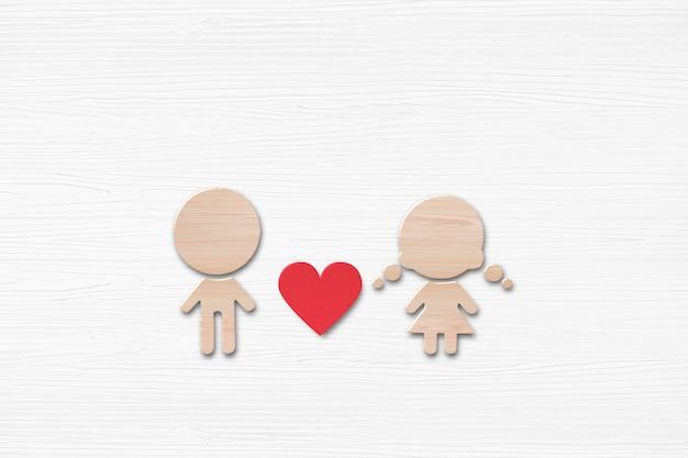 Houten vorm van vrouwen en mannen met rood hart op witte houten achtergrond. valentijnsdag concept.