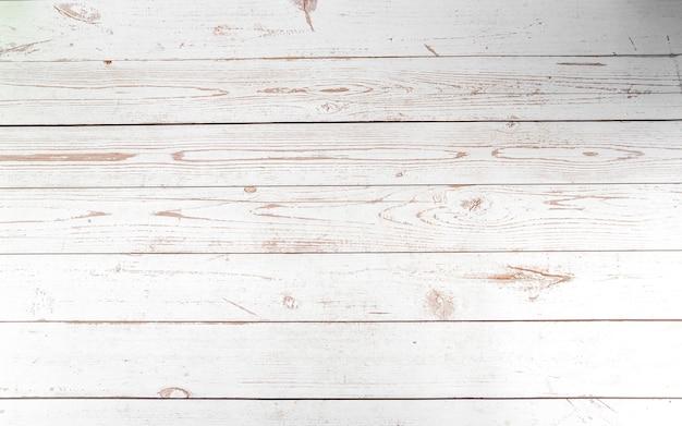 Houtstructuur of achtergrond tabelstijl van witte planken met donkere korrels