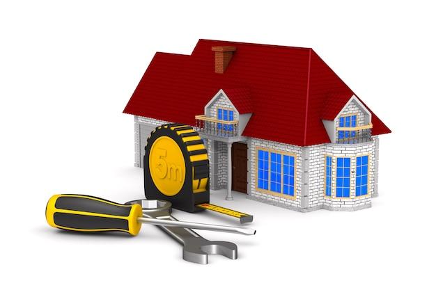 Huis en hulpmiddelen op wit oppervlak. geïsoleerde 3d-afbeelding. Premium Foto