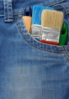 Hulpmiddel op de zak van de jeanstextuur