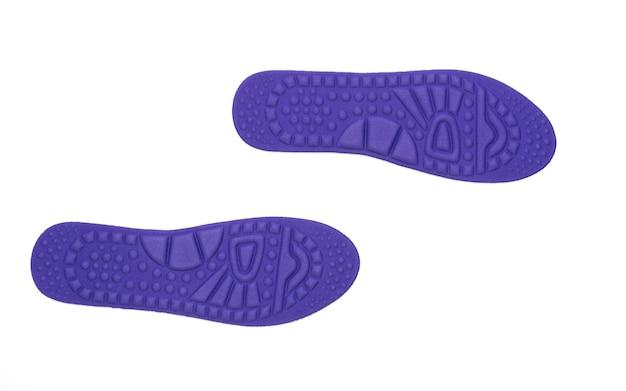 Hygiënische inlegzolen voor de schoenen op wit wordt geïsoleerd