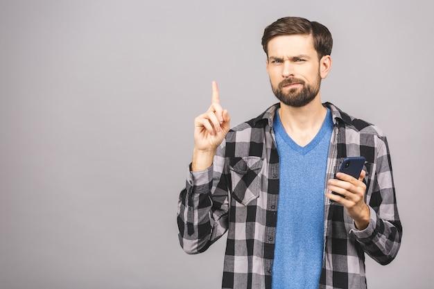 Idee! jonge stijlvolle hipster man verhoogt wijsvinger